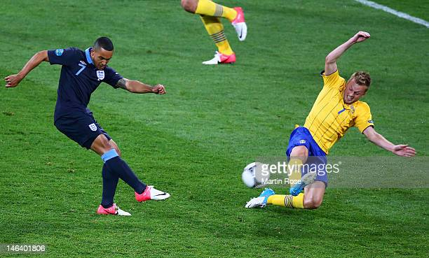 Theo Walcott of England scores their second goal during the UEFA EURO 2012 group D match between Sweden and England at The Olympic Stadium on June 15...