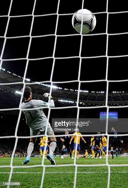 Theo Walcott of England scores their second goal past Andreas Isaksson of Sweden during the UEFA EURO 2012 group D match between Sweden and England...