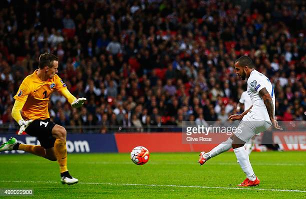 Theo Walcott of England shoots and scores the first goal past Mihkel Aksalu of Estonia during the UEFA EURO 2016 Group E qualifying match between...