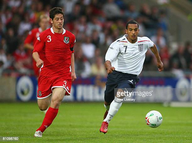 Theo Walcott of England U21 beats Joe Jacobson of Wales U21 during the Nationwide Under 21 International Friendly between Wales U21 and England U21...