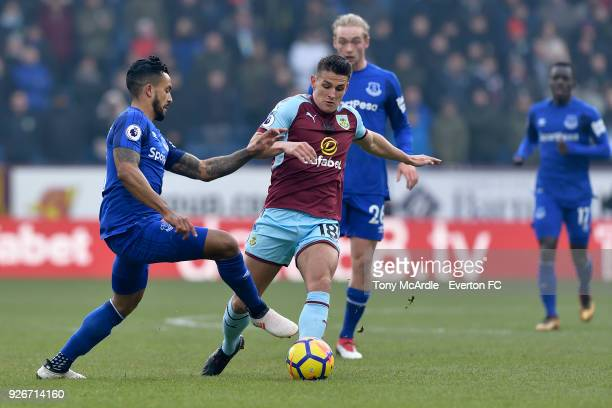 Theo Walcott of Everton and Ashley Westwood of Vurnley challenge for the ball during the Premier League match between Burnley and Everton at Turf...