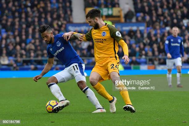 Theo Walcott of Everton and Davy Propper challenge for the ball during the Premier League match between Everton and Brighton and Hove Albion at...