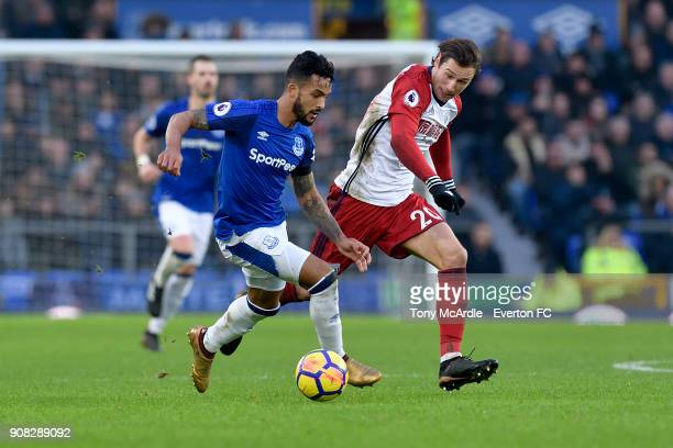 Theo Walcott of Everton and Grzegorz Krychowiak during the Premier League match between Everton and West Bromwich Albion at Goodison Park on January...
