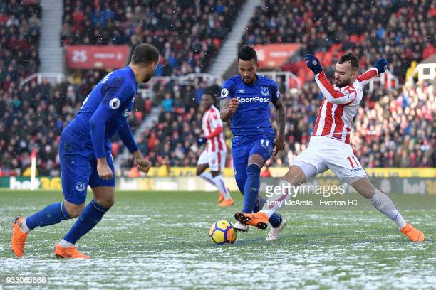 Theo Walcott of Everton and Jese challenge for the ball during the Premier League match between Stoke City and Everton at the Bet365 Stadium on March...