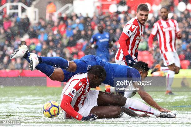 Theo Walcott of Everton and Kurt Zouma of Stoke City clash during the Premier League match between Stoke City and Everton at Bet365 Stadium on March...