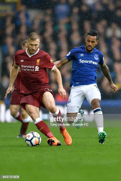 Theo Walcott of Everton and Ragnar Klavan of Liverpool challenge for the ball during the Premier League match between Everton and Liverpool at...