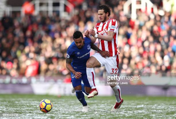 Theo Walcott of Everton and Ramadan Sobhi of Stoke City battle for the ball during the Premier League match between Stoke City and Everton at Bet365...