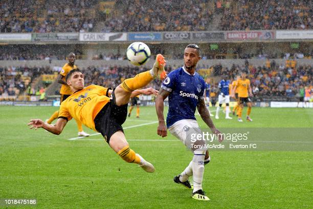 Theo Walcott of Everton and Ruben Vinagre challenge for the ball during the Premier League match between Wolverhampton Wanderers and Everton FC at...