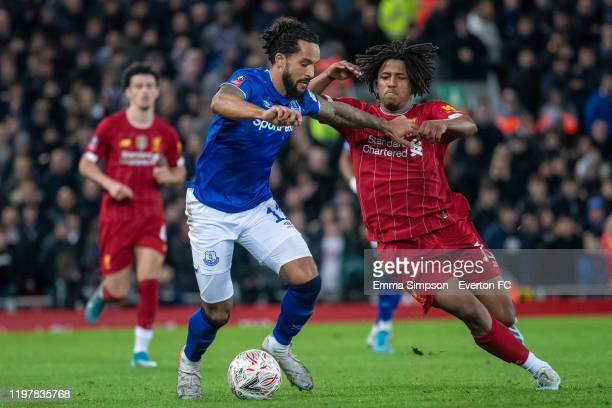 Theo Walcott of Everton and Yasser Larouci of Liverpool fight for possession during the FA Cup Third Round match between Liverpool and Everton at...