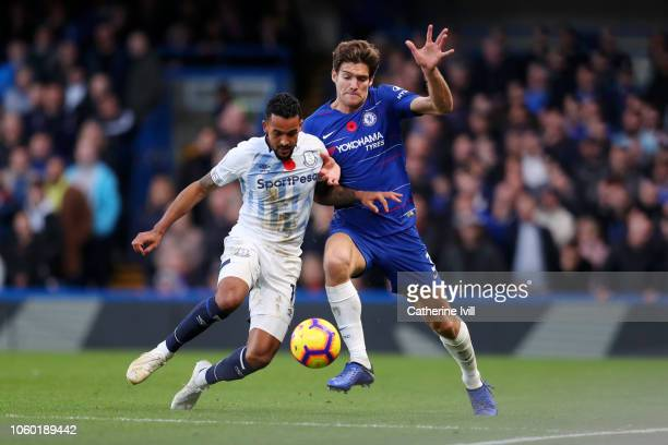 Theo Walcott of Everton battles for possession with Marcos Alonso of Chelsea during the Premier League match between Chelsea FC and Everton FC at...