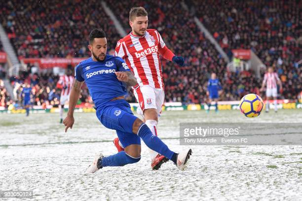Theo Walcott of Everton battles for the ball during the Premier League match between Stoke City and Everton at the Bet365 Stadium on March 17 2018 in...