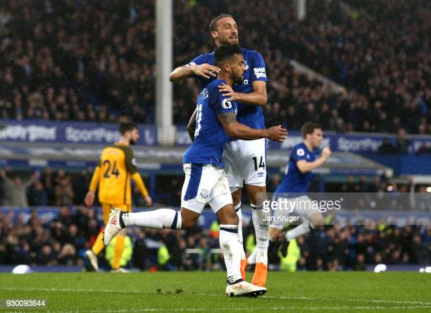 Theo Walcott of Everton celebrates after his sides first goal Cenk Tosun of Everton during the Premier League match between Everton and Brighton and...