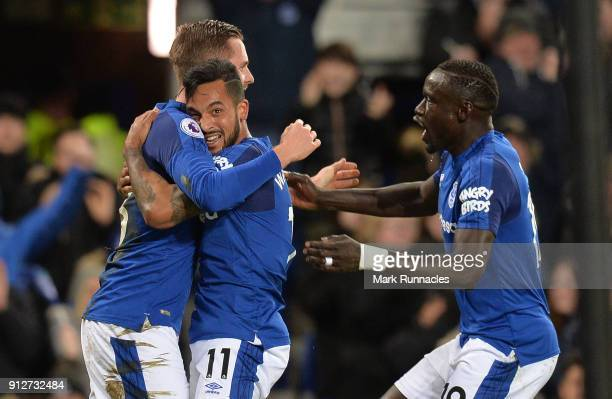 Theo Walcott of Everton celebrates after scoring his sides first goal with Gylfi Sigurdsson of Everton and Oumar Niasse of Everton during the Premier...