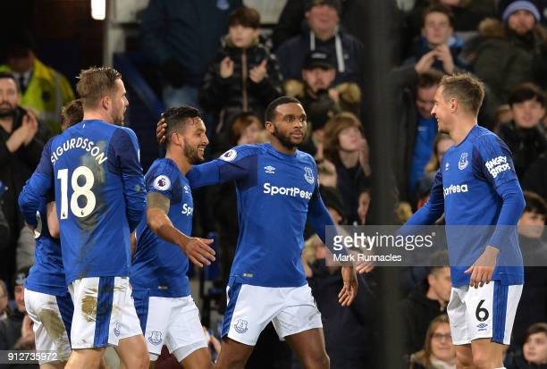 Theo Walcott of Everton celebrates after scoring his sides second goal with his team mates during the Premier League match between Everton and...