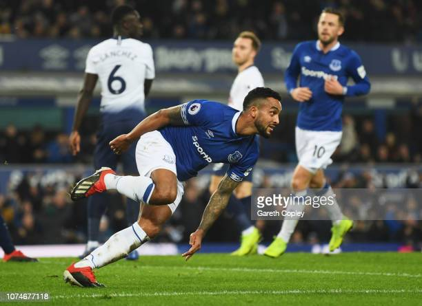 Theo Walcott of Everton celebrates after scoring his team's first goal during the Premier League match between Everton FC and Tottenham Hotspur at...