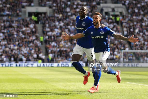 Theo Walcott of Everton celebrates after scoring his team's first goal during the Premier League match between Tottenham Hotspur and Everton FC at...