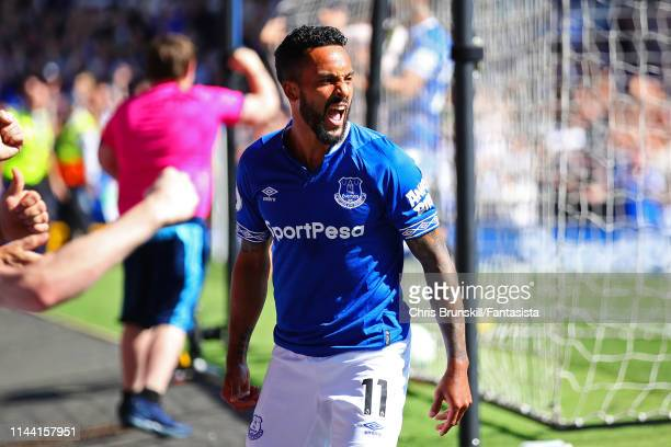 Theo Walcott of Everton celebrates scoring his side's fourth goal during the Premier League match between Everton FC and Manchester United at...