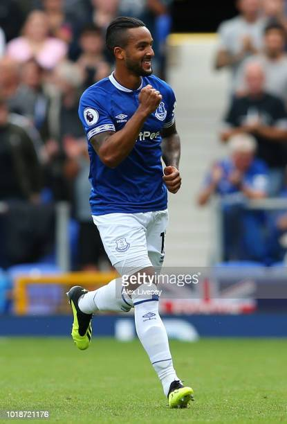 Theo Walcott of Everton celebrates scoring his team's first goal during the Premier League match between Everton FC and Southampton FC at Goodison...