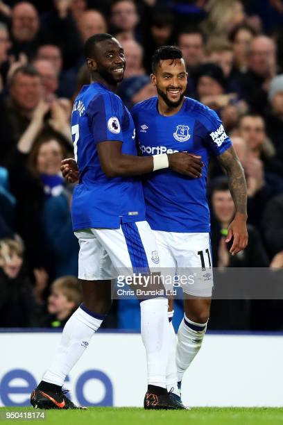 Theo Walcott of Everton celebrates scoring the opening goal with teammate Yannick Bolasie during the Premier League match between Everton and...