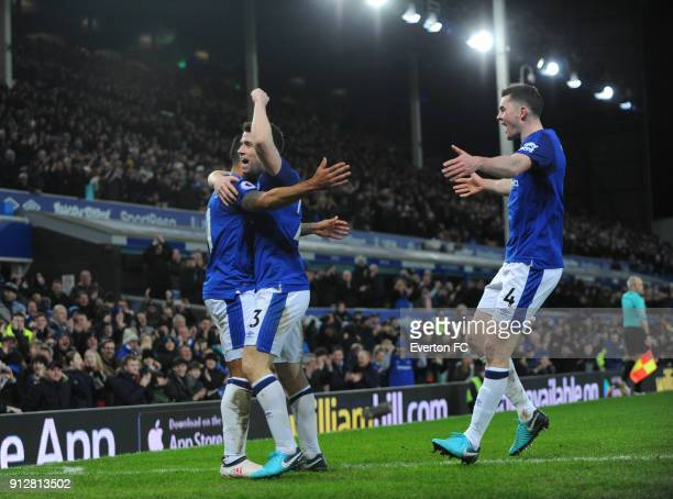 Theo Walcott of Everton celebrates with Seamus Coleman and Michael Keane after he scores the second goal during the Premier League match between...