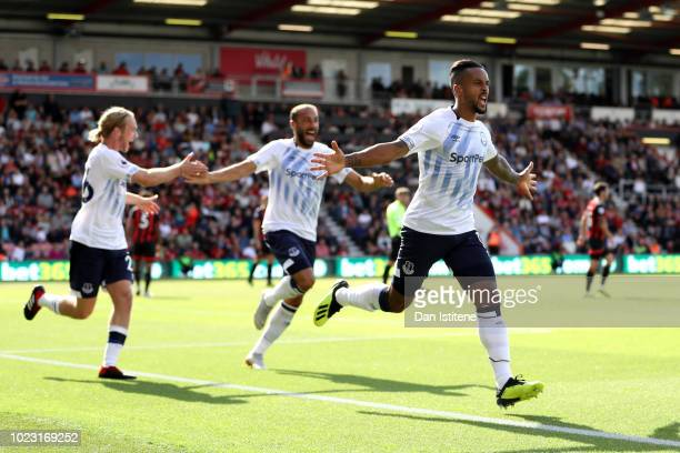 Theo Walcott of Everton celebrates with team mates after scoring his team's first goal during the Premier League match between AFC Bournemouth and...