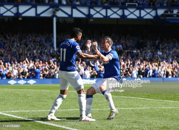 Theo Walcott of Everton celebrates with teammate Seamus Coleman after scoring his team's fourth goal during the Premier League match between Everton...