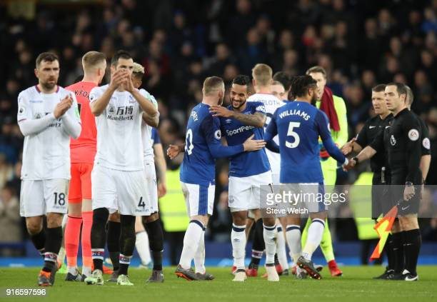 Theo Walcott of Everton congratulates teammate Wayne Rooney after the Premier League match between Everton and Crystal Palace at Goodison Park on...