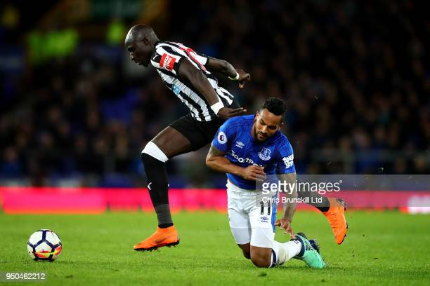 Theo Walcott of Everton in action with Mohamed Diame of Newcastle United during the Premier League match between Everton and Newcastle United at...