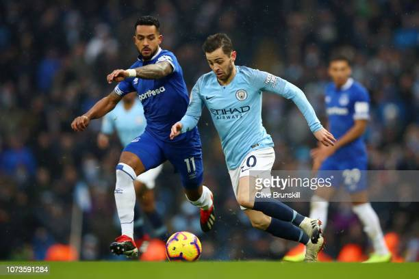 Theo Walcott of Everton is challenged by Bernardo Silva of Manchester City during the Premier League match between Manchester City and Everton FC at...