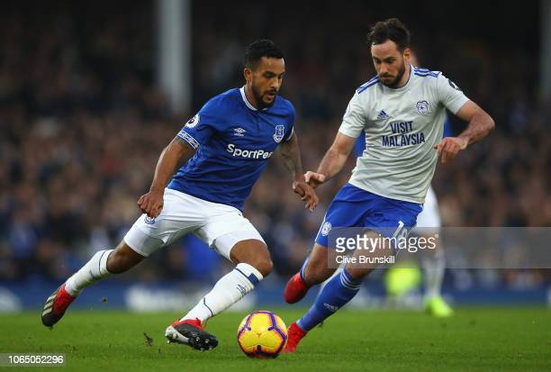 Theo Walcott of Everton is challenged by Greg Cunningham of Cardiff City during the Premier League match between Everton FC and Cardiff City at...