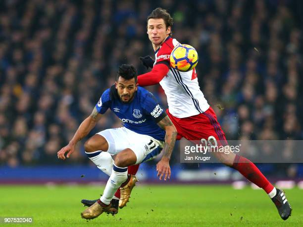 Theo Walcott of Everton is challenged by Grzegorz Krychowiak of West Bromwich Albion during the Premier League match between Everton and West...