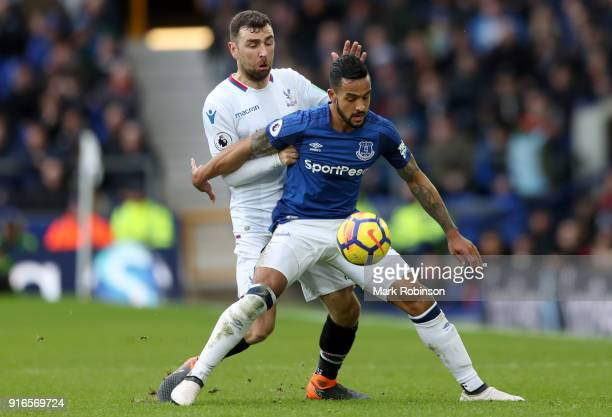 Theo Walcott of Everton is challenged by James McArthur of Crystal Palace during the Premier League match between Everton and Crystal Palace at...