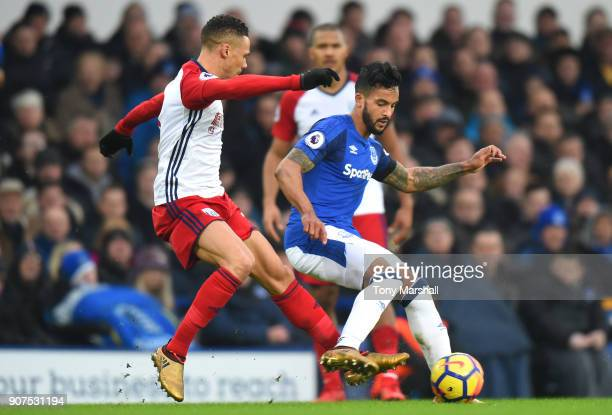Theo Walcott of Everton is challenged by Kieran Gibbs of West Bromwich Albion during the Premier League match between Everton and West Bromwich...