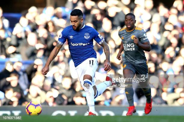 Theo Walcott of Everton is closed down by Nampalys Mendy of Leicester City during the Premier League match between Everton FC and Leicester City at...