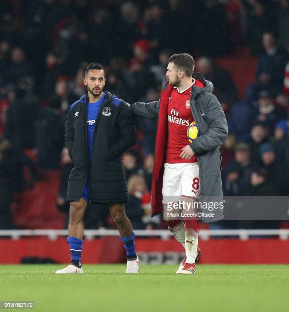 Theo Walcott of Everton is consoled by Aaron Ramsey of Arsenal who has the ball under his coat for his hattrick after the Premier League match...