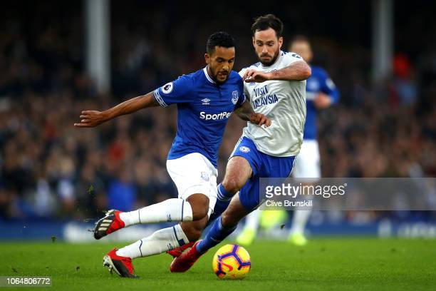 Theo Walcott of Everton is tackled by Greg Cunningham of Cardiff City during the Premier League match between Everton FC and Cardiff City at Goodison...