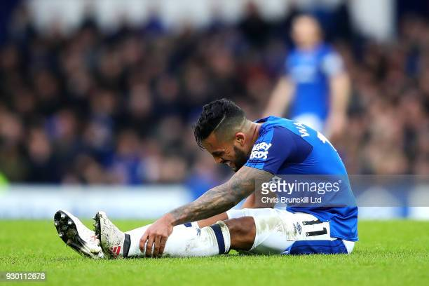 Theo Walcott of Everton lies injured during the Premier League match between Everton and Brighton and Hove Albion at Goodison Park on March 10 2018...