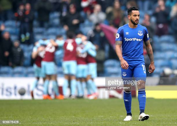 Theo Walcott of Everton looks dejected following Ashley Barnes of Burnley scoring his side's first goal during the Premier League match between...