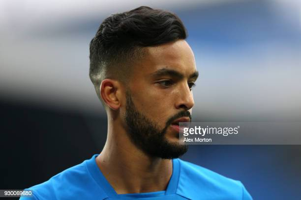 Theo Walcott of Everton looks on during the warm up prior to the Premier League match between Everton and Brighton and Hove Albion at Goodison Park...