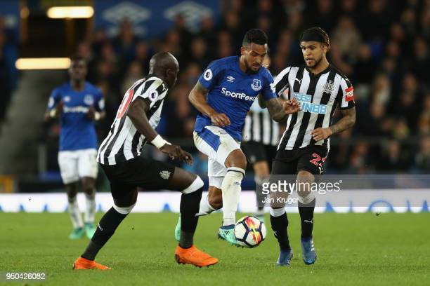 Theo Walcott of Everton Mohamed Diame of Newcastle United and Deandre Yedlin of Newcastle United in action during the Premier League match between...