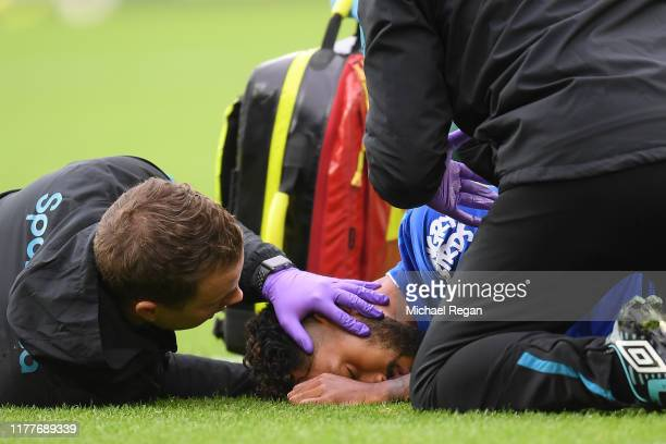 Theo Walcott of Everton receives medical treatment during the Premier League match between Everton FC and Manchester City at Goodison Park on...