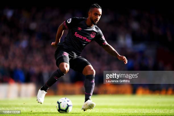 Theo Walcott of Everton runs with the ball during the Premier League match between Arsenal FC and Everton FC at Emirates Stadium on September 23 2018...