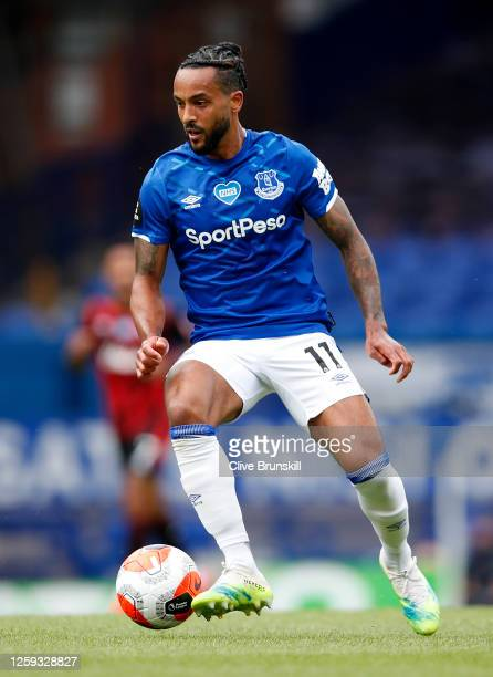 Theo Walcott of Everton runs with the ball during the Premier League match between Everton FC and AFC Bournemouth at Goodison Park on July 26 2020 in...