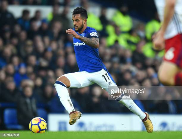 Theo Walcott of Everton runs with the ball during the Premier League match between Everton and West Bromwich Albion at Goodison Park on January 20...