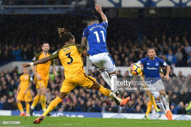 Theo Walcott of Everton scores during the Premier League match between Everton and Brighton and Hove Albion at Goodison Park on March 10 2018 in...