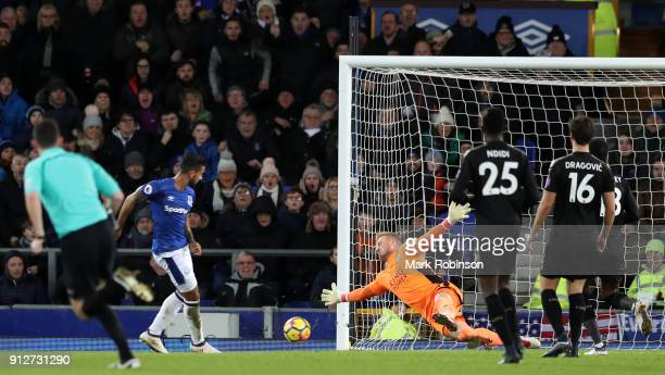 Theo Walcott of Everton scores his sides first goal during the Premier League match between Everton and Leicester City at Goodison Park on January 31...