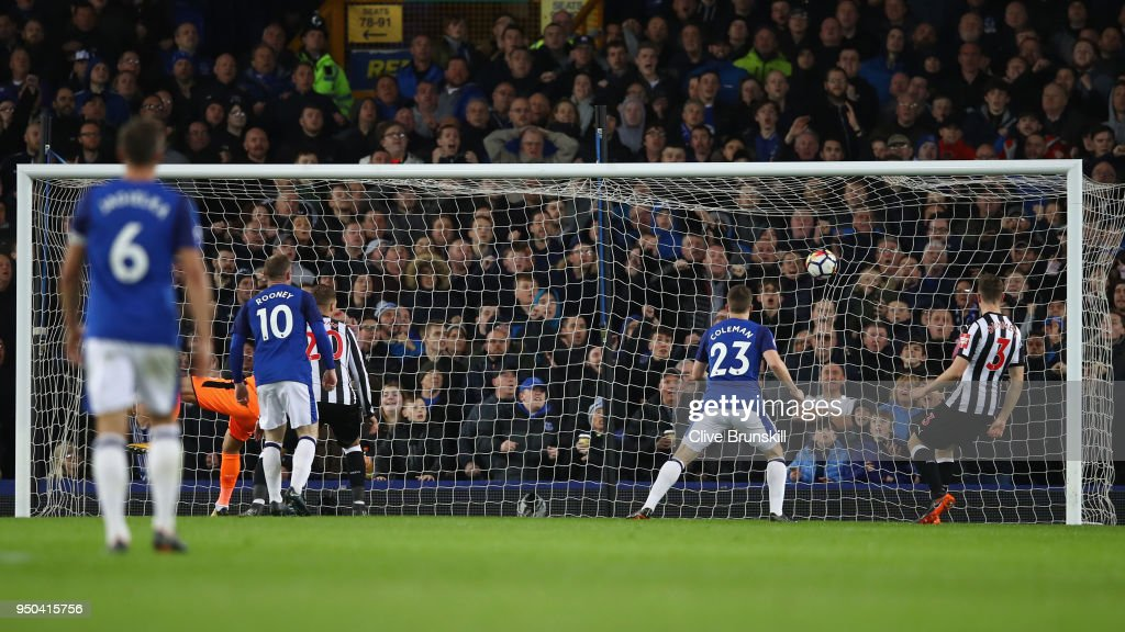 Theo Walcott of Everton (not pictured) scores his sides first goal during the Premier League match between Everton and Newcastle United at Goodison Park on April 23, 2018 in Liverpool, England.