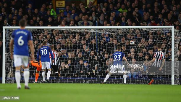 Theo Walcott of Everton scores his sides first goal during the Premier League match between Everton and Newcastle United at Goodison Park on April...