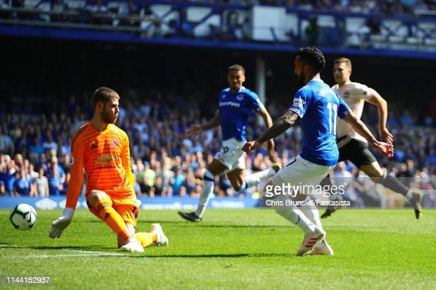 Theo Walcott of Everton scores his side's fourth goal during the Premier League match between Everton FC and Manchester United at Goodison Park on...