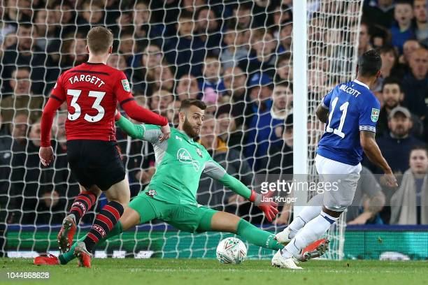 Theo Walcott of Everton scores his team's first goal during the Carabao Cup Third Round match between Everton and Southampton at Goodison Park on...